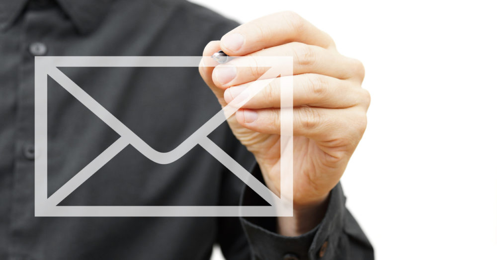 Man drawing email icon on virtual screen.  Contact information concept